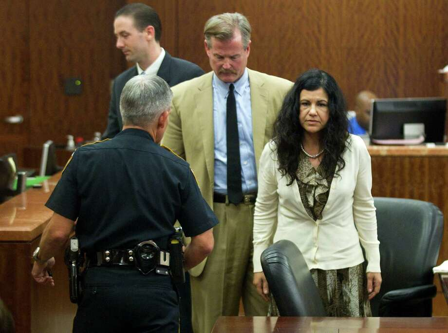 Ana Lilia Trujillo, right, stands just before being taken from the courtroom, and into custody, after being found guilty of killing her boyfriend, after the jury deliberated less than two hours, on Tuesday, April 8, 2014, in Houston. Trujillo, 45, was found guilty murder, in the killing her 59-year-old boyfriend, Alf Stefan Andersson with the heel of a stiletto shoe, at his Museum District high-rise condominium in June 2013. Photo: Brett Coomer, Houston Chronicle / © 2014 Houston Chronicle