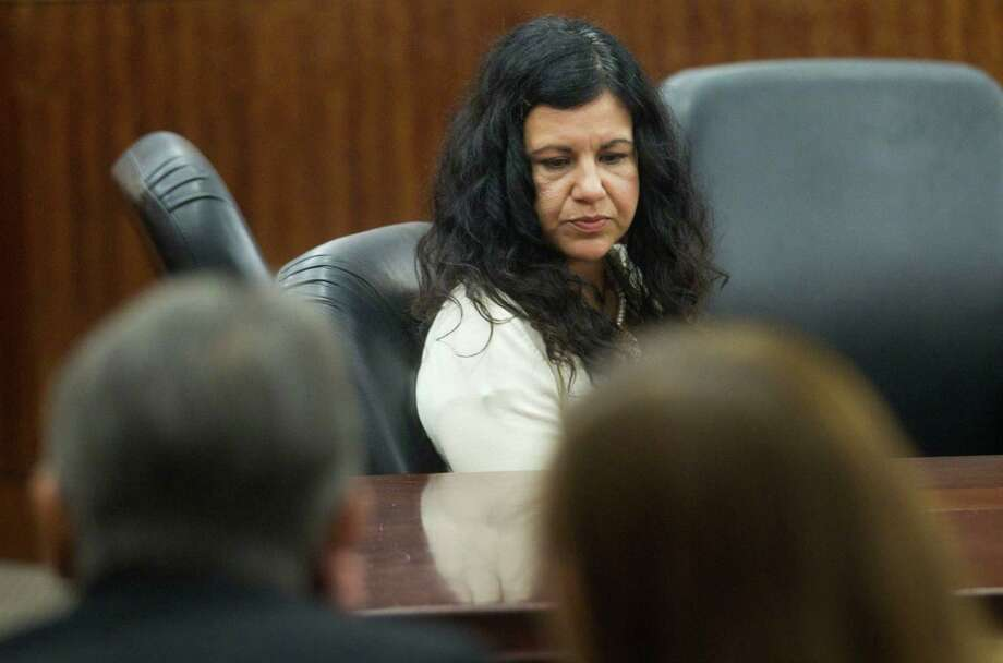 Ana Lilia Trujillo sits alone at the defense table after being found guilty of killing her boyfriend on Tuesday, April 8, 2014, in Houston. It took the jury less than two hours to find Trujillo, 45, was guilty of murder, in the killing her 59-year-old boyfriend, Alf Stefan Andersson, with the heel of a stiletto shoe, at his Museum District high-rise condominium in June 2013. Photo: Brett Coomer, Houston Chronicle / © 2014 Houston Chronicle