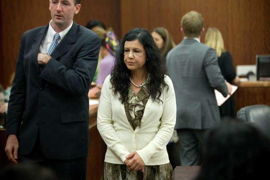 Ana Lilia Trujillo stands in the courtroom following closing arguments in her trial Tuesday, April 8, 2014, in Houston. Trujillo, 45, is charged with murder, accused of killing her 59-year-old boyfriend, Alf Stefan Andersson with the heel of a stiletto shoe, at his Museum District high-rise condominium in June 2013. Photo: Brett Coomer, Houston Chronicle / © 2014 Houston Chronicle