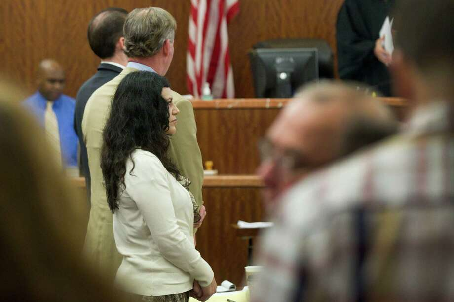 Ana Lilia Trujillo stands in the courtroom during her trial Tuesday, April 8, 2014, in Houston. Trujillo, 45, is charged with murder, accused of killing her 59-year-old boyfriend, Alf Stefan Andersson with the heel of a stiletto shoe, at his Museum District high-rise condominium in June 2013. Photo: Brett Coomer, Houston Chronicle / © 2014 Houston Chronicle