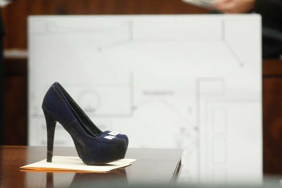 Ana Lilia Trujillo's shoes, a pair of fashionable, cobalt blue platform pumps with 5-inch heel, are entered into evidence during her trial Tuesday, April 1, 2014.