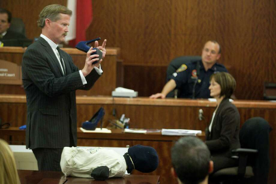 Defense attorney Jack Carroll questions Houston police senior officer Christopher Duncan, crime scene investigator, during the trial against Ana Lilia Trujillo  Tuesday, April 1, 2014, in Houston. Photo: Brett Coomer, Houston Chronicle / © 2014 Houston Chronicle