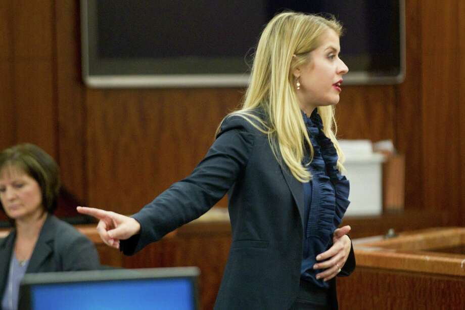 Prosecutor Sarah Mickelson gives her opening argument on Monday, March 31, 2014. Photo: Brett Coomer, Houston Chronicle / © 2014 Houston Chronicle