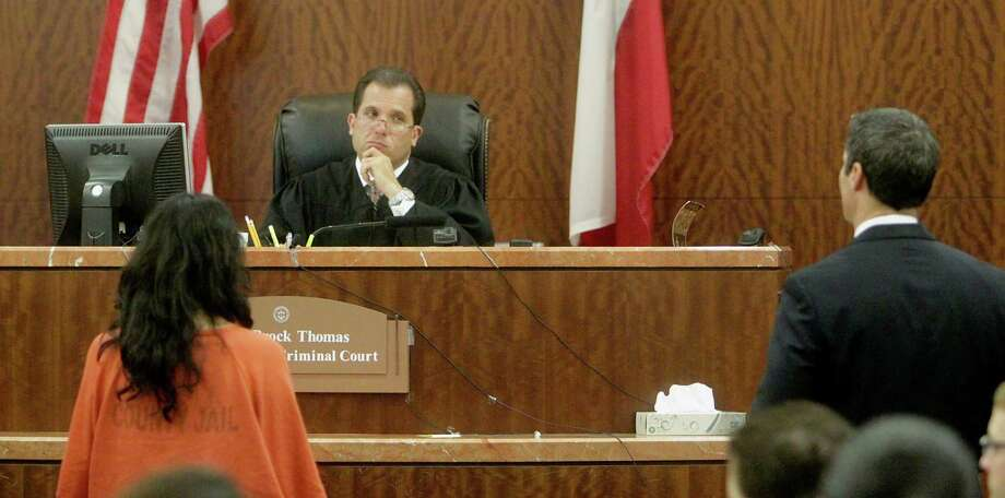 State District Judge Brock Thomas listens to Harris County prosecutor John Jordan in June. Photo: James Nielsen, Houston Chronicle / © 2013  Houston Chronicle