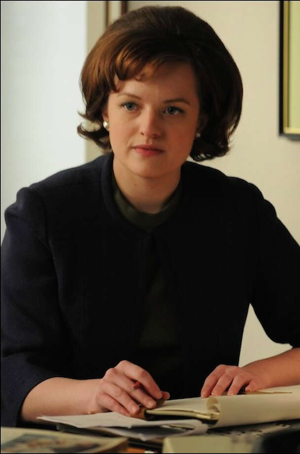"Peggy Olson (Elisabeth Moss) in Season 4 of ""Mad Men.""   ""Peggy has changed the most of any character on the show."" Tom says of the secretary who has worked her way up the ""Mad Men"" ladder.   ""The wardrobe Janie has picked for her reflects that."" Photo: Mike Yarish, AMC / SFC"