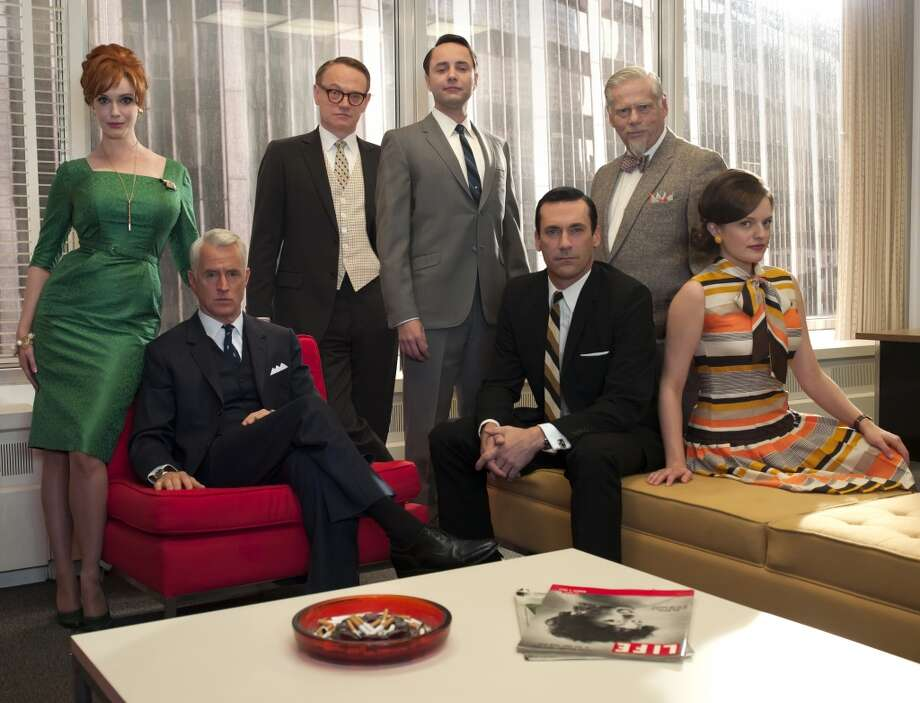 "Peggy, seen here with ""Mad Men"" cast members (from left) Christina Hendricks, John Slattery, Jared Harris, Vincent Kartheiser, Jon Hamm, Robert and Robert Morse in the fifth season, has never entirely fit in with either the men or the women of the agency.  ""She's unlike all the women on the show,"" Tom points out. ""Betty was sort of a Grace Kelly until she got fat and dyed her hair, now she's Grace Kelly again. Joan is obviously the Marilyn Monroe and Megan is vaguely Sharon Tate styled. Peggy doesn't have a box she fits into. Don is the person on the show she's probably the most like."" Photo: Frank Ockenfels, Associated Press"