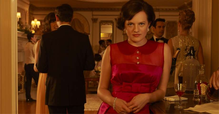 """Although Peggy will never have the """"va-va-voom"""" (in Tom's words) wardrobe of a Joan as the character has become more sexually liberated her clothes have started to tip their toes toward being slightly more provocative. This red dress from season six is a nice transitional piece between the two Peggys. Photo: Frank Ockenfels, AMC"""