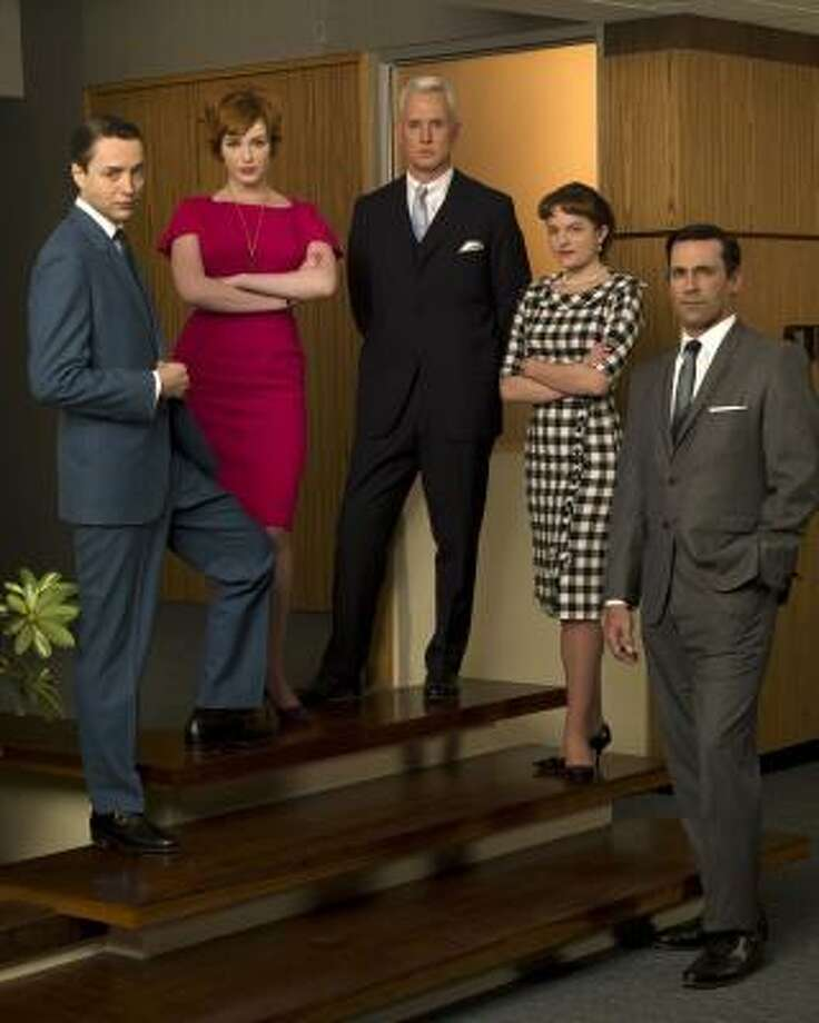 "The cast early in the ""Mad Men"" run. Note the conservative check dress on Peggy."