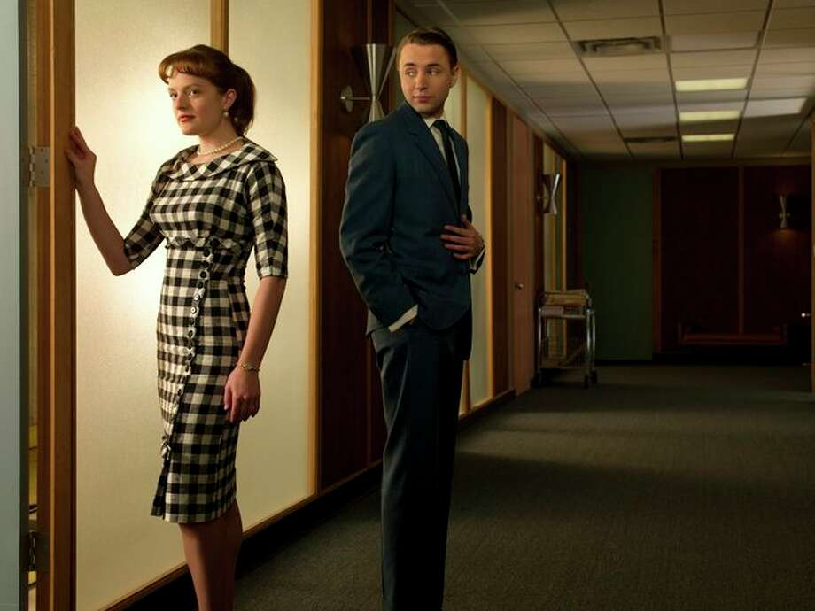 Elisabeth Moss as Peggy with Vincent Kartheiser as Pete Campbell. Photo: AMC, AP