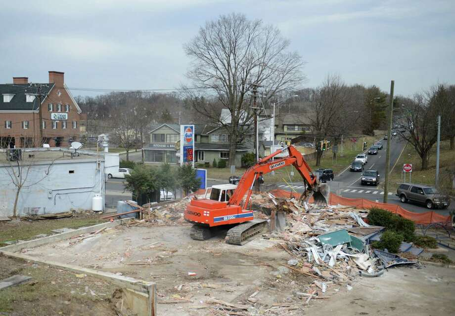Two long-standing buildings are demolished at the intersection of North Street and Padanaram Avenue next to I-84 exit six in Danbury, Conn. Friday, April 11, 2014. Photo: Tyler Sizemore / The News-Times