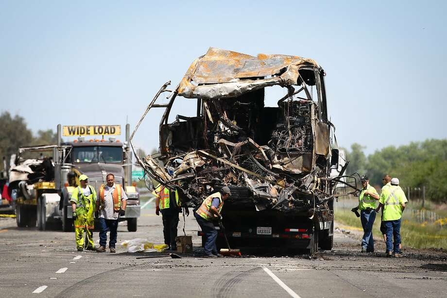 ORLAND, CA - APRIL 11: A bus involved in Thursday's deadly crash is loaded on to a truck at the scene on April 11, 2014  in Orland, California. Ten people were killed and dozens injured, including four still in critical condition, after a FedEx truck collided with a bus of high school students on Interstate 5 yesterday. The students were on their way to visit Humboldt State University in Northern California. (Photo by Elijah Nouvelage/Getty Images) Photo: Elijah Nouvelage, Getty Images
