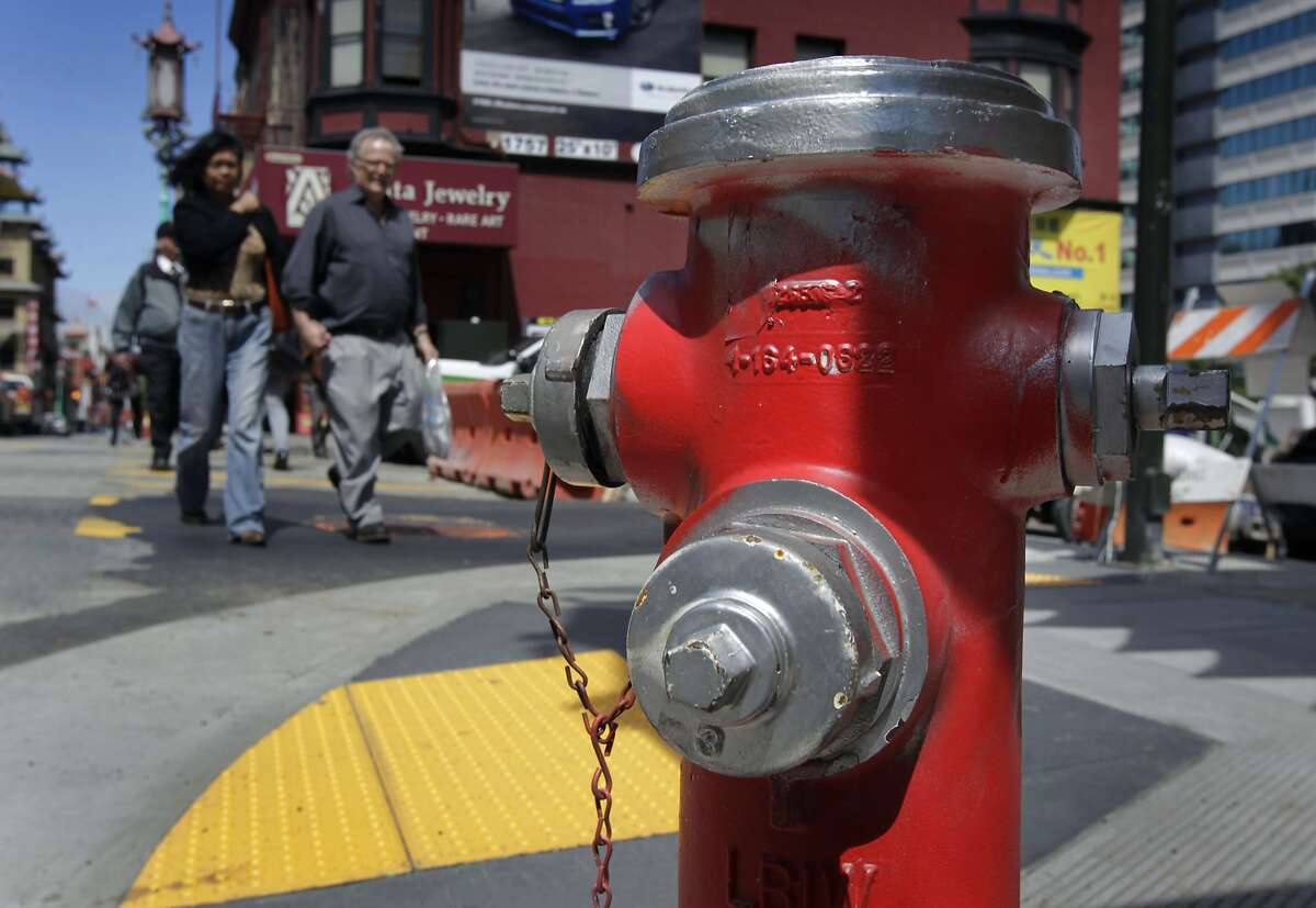 A fire hydrant, illegally painted by vandals, is at Grant Avenue and Pine Street in San Francisco, Calif. on Wednesday, April 9, 2014. City water department crews have been busy replacing the painted hydrants with others that have been refurbished and repainted white at a cost of thousands to the city.