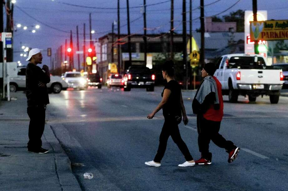 Pedestrians cross the 200 block of N. Zarzamora at dusk. A reader reminds us that pedestrian safety is a two-way street. Photo: Marvin Pfeiffer / San Antonio Express-News / Express-News 2013