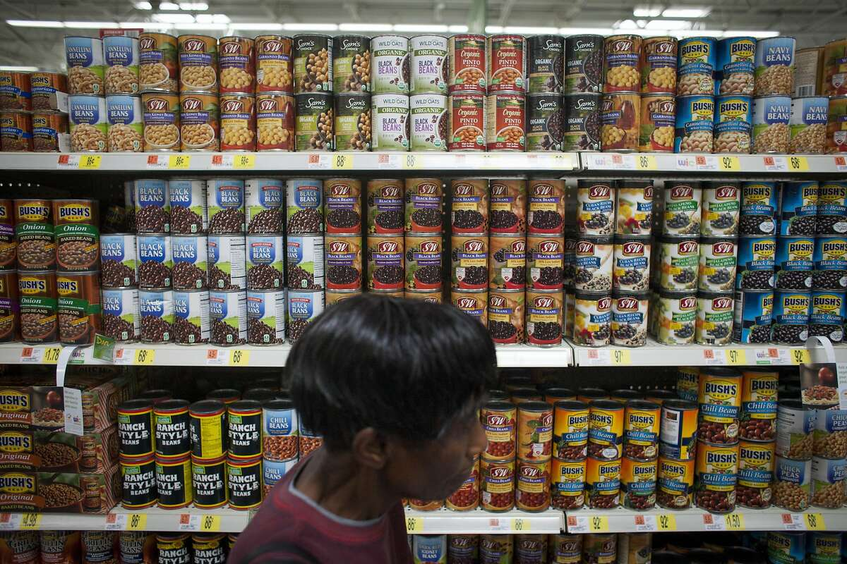 A Walmart shopper passes by Wild Oats Organic Beans at a Walmart in Oakland on April 11th 2014. The Wild Oats products will be sold at half the price of competing organic brands.