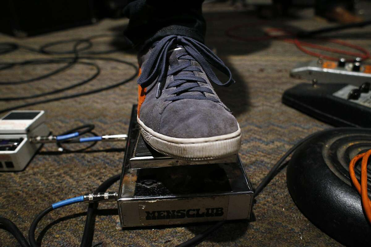 Guitarist Ron Nudelman pushes a Morley Wah-Wah pedal as he and the band Hot Lunch practice at Secret Studios in San Francisco, Calif., on Thursday, April 10, 2014.
