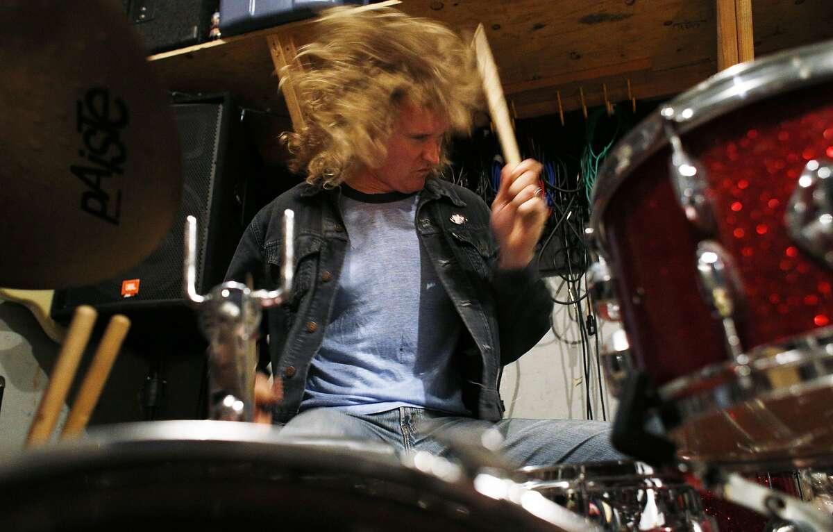 Rob Alper, drummer for Hot Lunch, practices at Secret Studios in San Francisco, Calif., on Thursday, April 10, 2014.