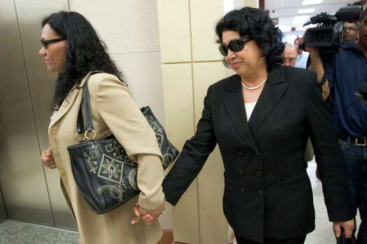 Maria Tharp, right, mother of Ana Trujillo, leaves the courtroom after her daughter was sentenced to life in prison for killing her boyfriend with the heel of a stiletto shoe Friday, April 11, 2014, in Houston. Trujillo was convicted in the brutal 2013 slaying of, Alf Stefan Andersson, using a 5-inch stiletto shoe. Photo: Brett Coomer, Houston Chronicle / © 2014 Houston Chronicle