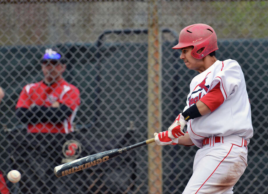 Jonathan Dreher of Greenwich drives in a run during the high school baseball game between Greenwich High School and New Canaan High School at Greenwich, Friday afternoon, April 11, 2014. Photo: Bob Luckey / Greenwich Time