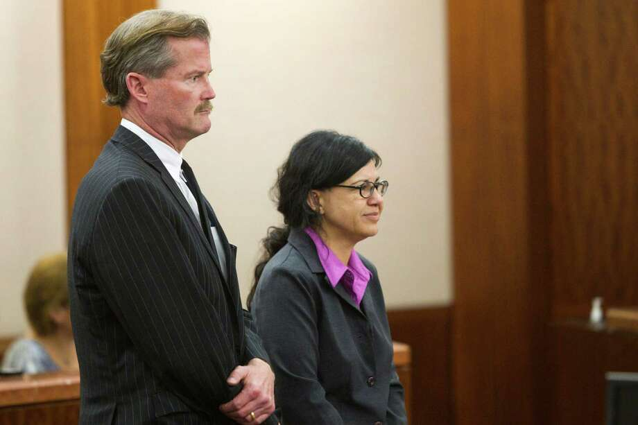 Ana Trujillo stands with her attorney, Jack Carroll, as she is sentenced to life in prison for killing her boyfriend with the heel of a stiletto shoe Friday, April 11, 2014, in Houston. Trujillo was convicted in the brutal 2013 slaying of, Alf Stefan Andersson, using a 5-inch stiletto shoe. Photo: Brett Coomer, Houston Chronicle / © 2014 Houston Chronicle