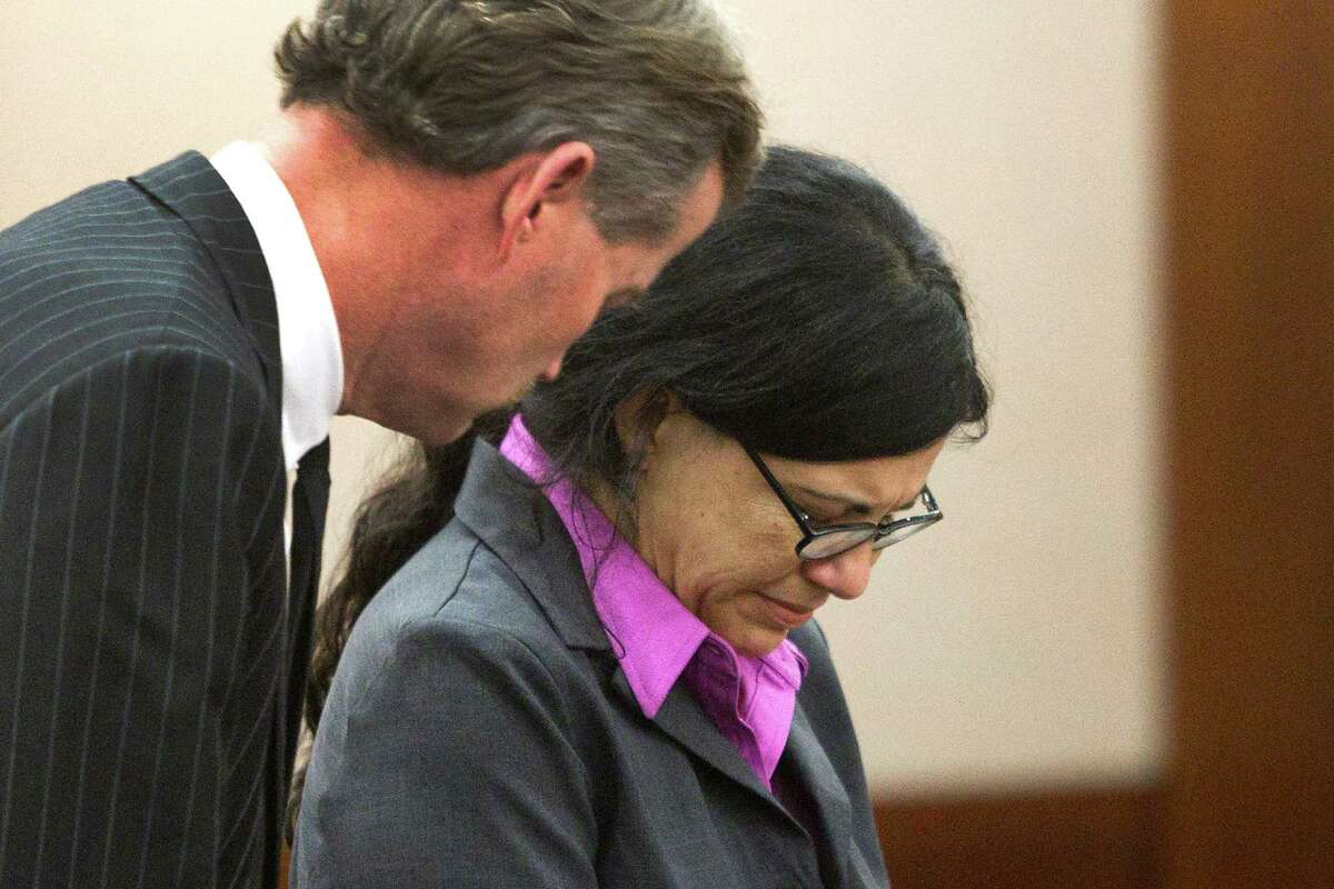 Ana Trujillo stands with her attorney, Jack Carroll, left, as she is sentenced to life in prison for killing her boyfriend with the heel of a stiletto shoe Friday, April 11, 2014, in Houston. Trujillo was convicted in the brutal 2013 slaying of, Alf Stefan Andersson, using a 5-inch stiletto shoe.