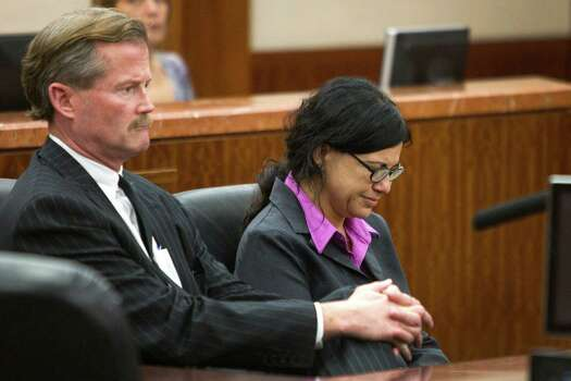 Ana Trujillo sits with her attorney, Jack Carroll, after she was sentenced to life in prison for killing her boyfriend with the heel of a stiletto shoe Friday, April 11, 2014, in Houston. Trujillo was convicted in the brutal 2013 slaying of, Alf Stefan Andersson, using a 5-inch stiletto shoe. Photo: Brett Coomer, Houston Chronicle / © 2014 Houston Chronicle