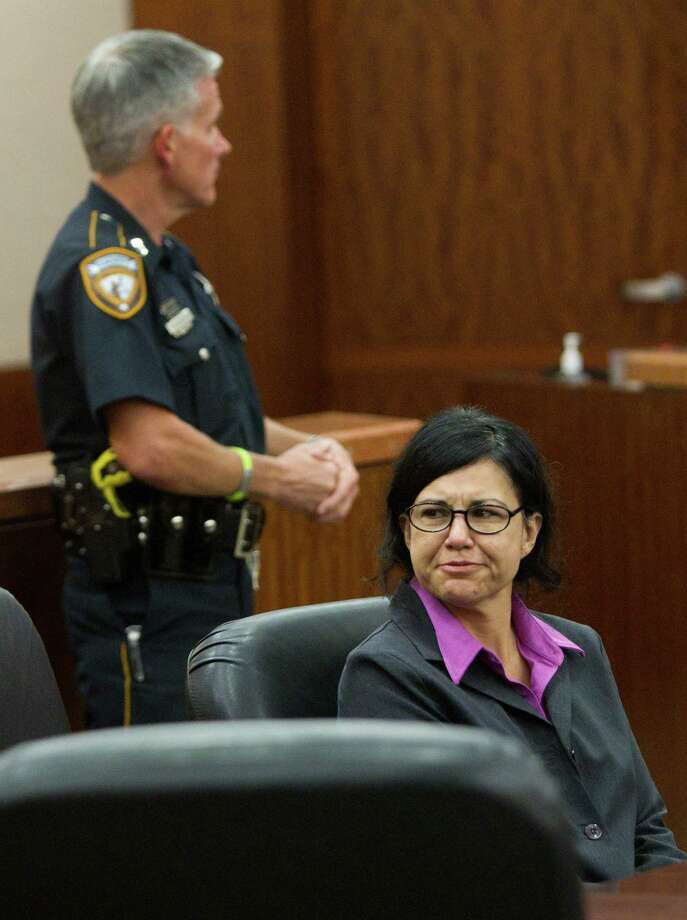 Ana Trujillo looks back at her family after she was sentenced to life in prison for killing her boyfriend with the heel of a stiletto shoe Friday, April 11, 2014, in Houston. Trujillo was convicted in the brutal 2013 slaying of, Alf Stefan Andersson, using a 5-inch stiletto shoe. Photo: Brett Coomer, Houston Chronicle / © 2014 Houston Chronicle