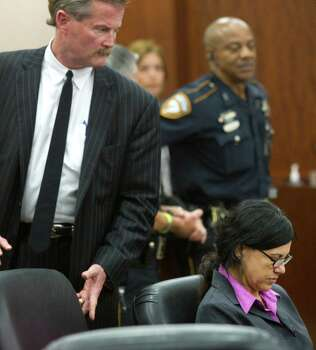 Ana Trujillo bows her head after she was sentenced to life in prison for killing her boyfriend with the heel of a stiletto shoe Friday, April 11, 2014, in Houston. Trujillo was convicted in the brutal 2013 slaying of, Alf Stefan Andersson, using a 5-inch stiletto shoe. Photo: Brett Coomer, Houston Chronicle / © 2014 Houston Chronicle
