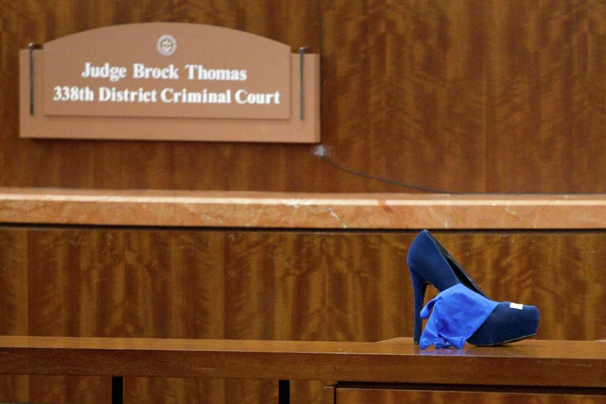 One of Ana Trujillo's shoes sits in front of District Court Judge Brock Thomas' bench before Trujillo is sentenced to life in prison for killing her boyfriend with the heel of a stiletto shoe Friday, April 11, 2014, in Houston. Trujillo was convicted in the brutal 2013 slaying of, Alf Stefan Andersson, using a 5-inch stiletto shoe.