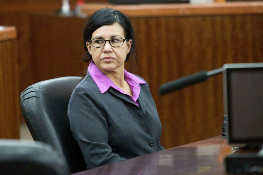 Convicted killer Ana Trujillo sits in the courtroom during closing arguments in the punishment phase of her trial on Friday, April 11, 2014, in Houston. Trujillo was convicted in the brutal 2013 slaying of her boyfriend, Alf Stefan Andersson, using a 5-inch stiletto shoe. Photo: Brett Coomer, Houston Chronicle / © 2014 Houston Chronicle