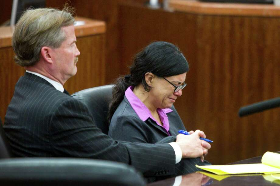 Convicted killer Ana Trujillo sits with her lawyer, Jack Carroll, during closing arguments in the punishment phase of her trial on Friday, April 11, 2014, in Houston. Trujillo was convicted in the brutal 2013 slaying of her boyfriend, Alf Stefan Andersson, using a 5-inch stiletto shoe. Photo: Brett Coomer, Houston Chronicle / © 2014 Houston Chronicle