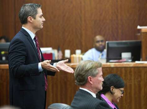 Prosecutor John Jordan, left, gives his closing argument in the punishment phase of the trial against convicted killer Ana Trujillo, right, on Friday, April 11, 2014, in Houston. Trujillo was convicted in the brutal 2013 slaying of her boyfriend, Alf Stefan Andersson, using a 5-inch stiletto shoe. Defense attorney Jack Carroll is shown seated next to Trujillo. Photo: Brett Coomer, Houston Chronicle / © 2014 Houston Chronicle