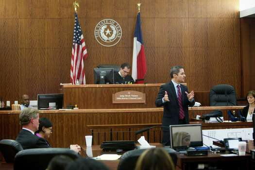 Prosecutor John Jordan, right, gives his closing argument in the punishment phase of the trial against convicted killer Ana Trujillo, left, on Friday, April 11, 2014, in Houston. Trujillo was convicted in the brutal 2013 slaying of her boyfriend, Alf Stefan Andersson, using a 5-inch stiletto shoe. Defense attorney Jack Carroll is shown seated next to Trujillo. Photo: Brett Coomer, Houston Chronicle / © 2014 Houston Chronicle