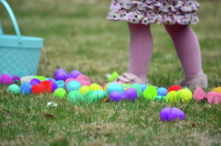 After the all the eggs had been collected after the Easter egg hunt, children took time to go through their treats on Friday, April 11. Photo: Megan Spicer / Darien News
