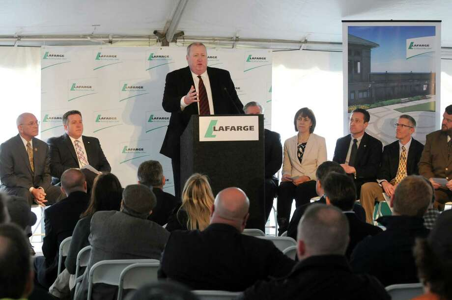 Lafarge U.S. President and CEO John Stull speaks as the Lafarge Ravena cement plant breaks ground for a modernization project on Friday April 11, 2014 in Ravena, N.Y. (Michael P. Farrell/Times Union) Photo: Michael P. Farrell / 00026442A