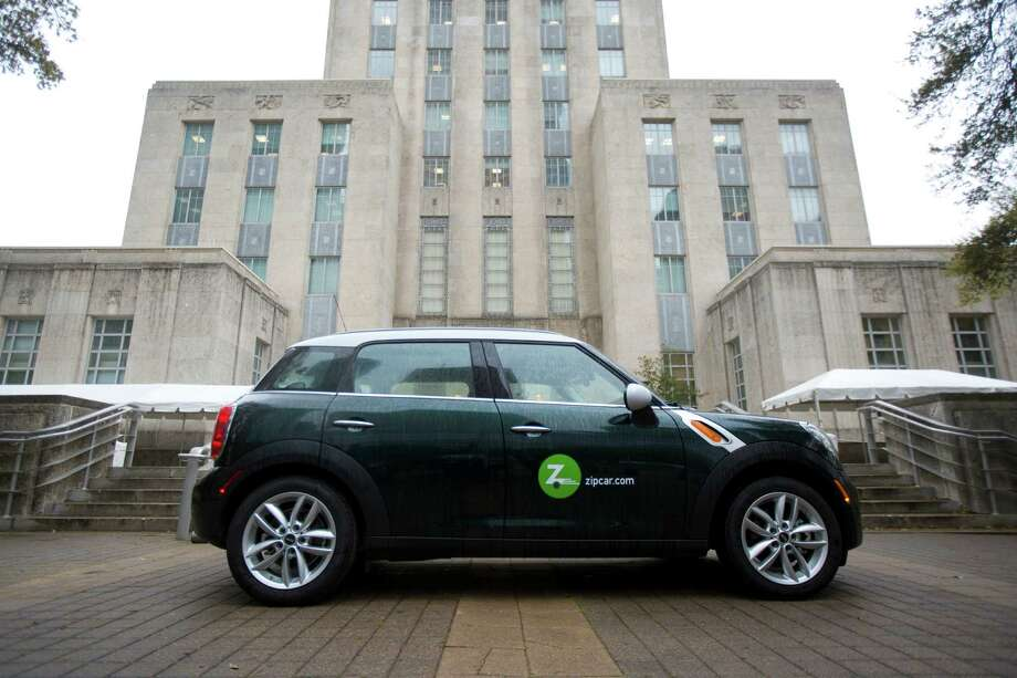 A Zipcar is parked on front of the Houston City Hall on March 26, 2014 as the company introduced the car-sharing service to Houston. Photo: Marie D. De Jesus, Staff / © 2014 Houston Chronicle