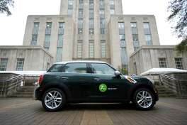 A Zipcar is parked on front of the Houston City Hall, Wednesday, March 26, 2014 as the company introduces the car-sharing service to Houston. Cars are available by the hour or by the day to residents, students, businesses and visitors.  ( Marie D. De Jesus / Houston Chronicle )