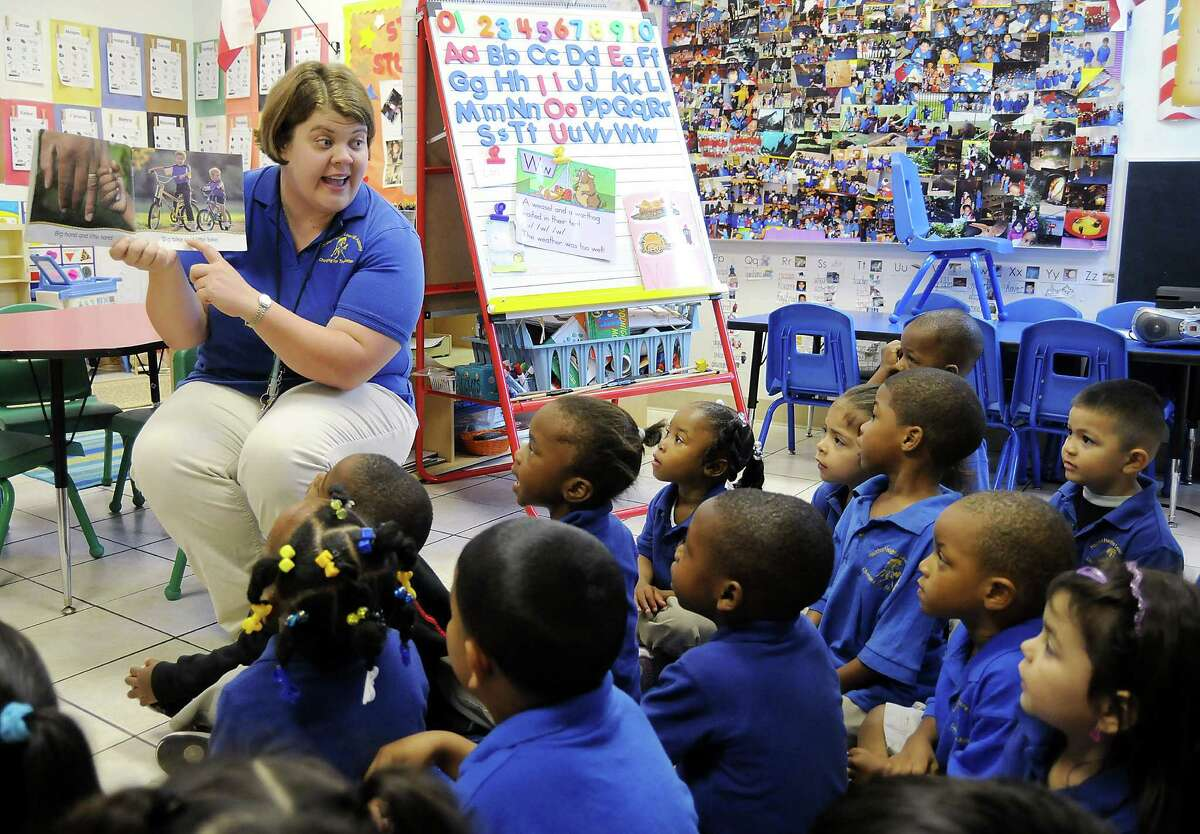 Teacher Rachel Simpson reads to her Pre-K III class at the Houston Heights Learning Academy Wednesday April 14,2010. (Dave Rossman Photo)
