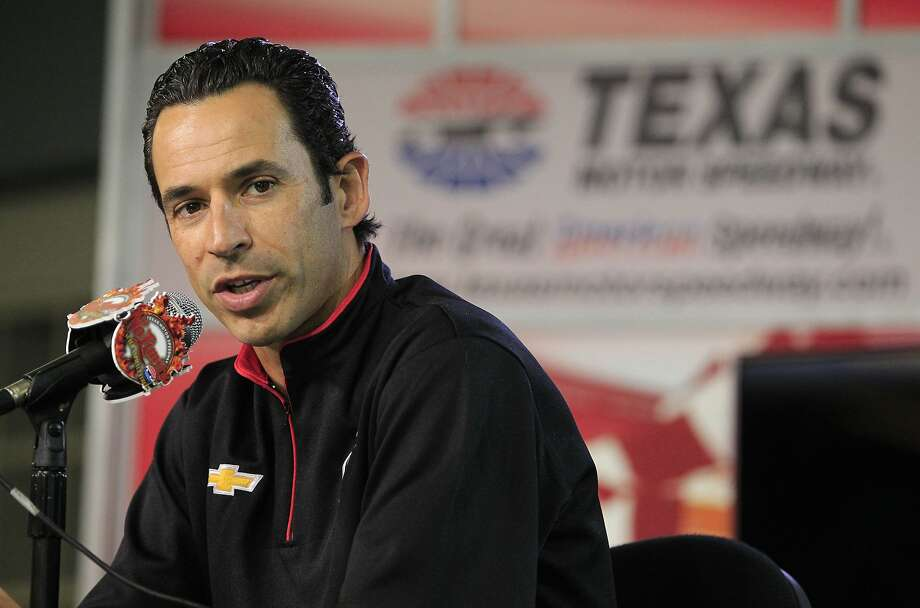 Indycar driver Helio Castroneves speaks at Texas Motor Speedway on Wednesday, March 19, 2014, in Fort Worth, Texas, where a high-definition video board was unveiled. The screen is 218 feet wide and about 95 feet high. It is about 125 feet above ground level in the middle of the backstretch at the 1 1/2-mile track. (AP Photo/Fort Worth Star Telegram, Paul Moseley) MAGS OUT (FORT WORTH WEEKLY, 360 WEST); INTERNET OUT Photo: Paul Moseley, Associated Press