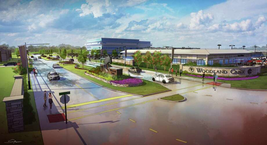 This rendering shows Woodland Creek, a mixed-use project near The Woodland and the Exxon Mobil campus. It will include high-end housing, office buildings and shops. Photo: Courtesy Of PinPoint Commercial