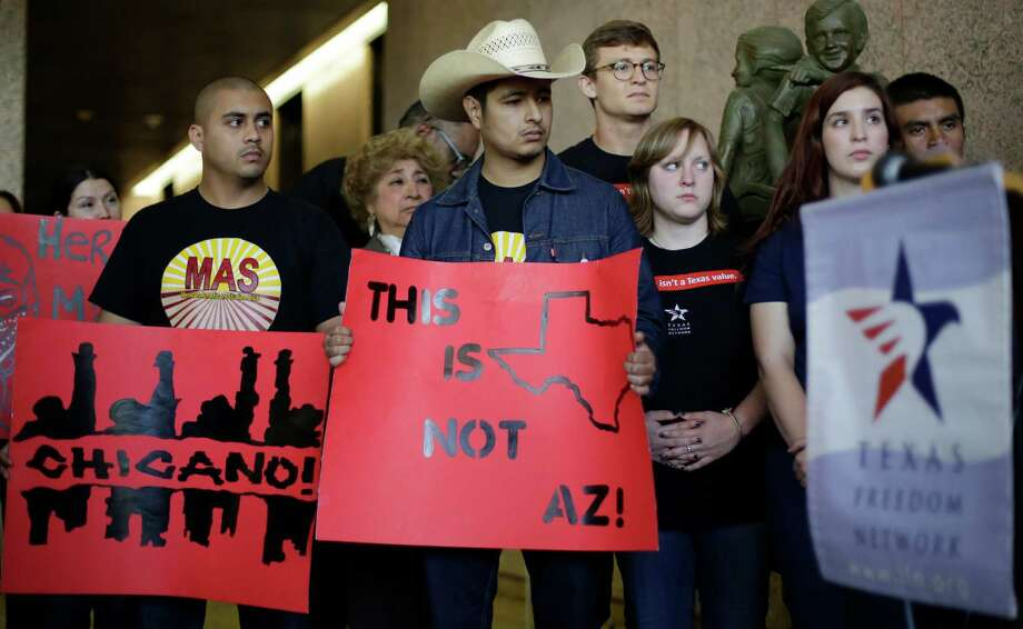 Supporters of a proposal to add a Mexican-American studies course as a statewide high school elective arrive for Texas arrive for a Texas Board of Education hearing, Tuesday, April 8, 2014, Austin, Texas. (AP Photo/Eric Gay) Photo: Eric Gay, STF / AP