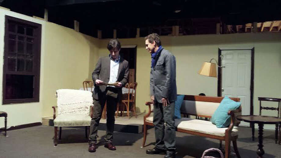 "Left to right are Chris Luongo of Bethel and Miles Everett of Thomaston rehearsing a scene from ""The Glass Menagerie,"" opening at Town Players of Newtown on Friday. Find out more.  Photo: Contributed Photo / The News-Times Contributed"