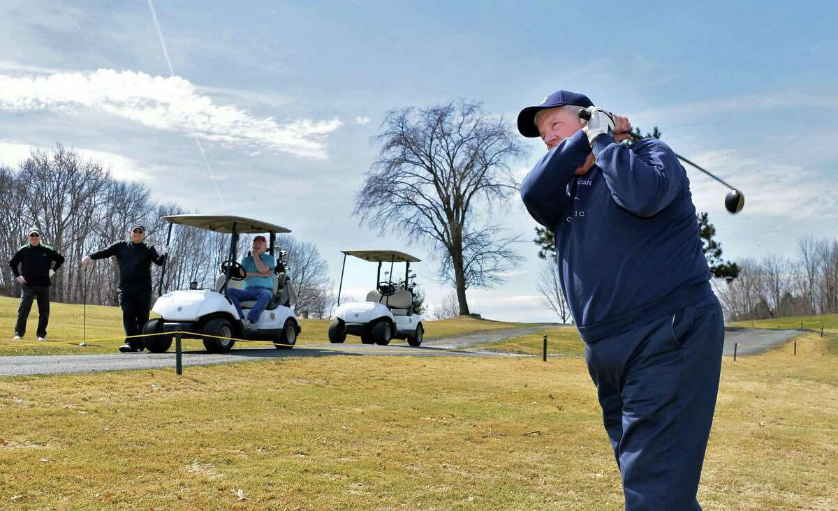 Pat Byrne of Troy enjoys perfect golfing weather as Frear Park Municipal Golf Course opens for the season Friday, April 11, 2014, in Troy, N.Y. (John Carl D'Annibale / Times Union)