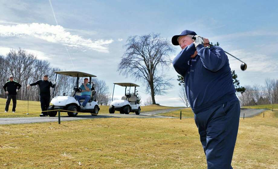 Pat Byrne of Troy enjoys perfect golfing weather as Frear Park Municipal Golf Course opens for the season Friday, April 11, 2014, in Troy, N.Y.  (John Carl D'Annibale / Times Union) Photo: John Carl D'Annibale / 00026450A