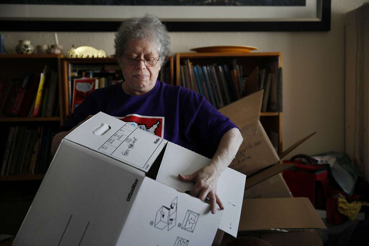 Sally Goldin, breaks down a moving box after unpacking it in her new apartment at a senior residence on Friday, April 4, 2014, in San Francisco, Calif. Goldin says she tries to unpack two boxes a day to keep making progress on organizing her new apartment since moving. Goldin received a buyout check to move out of the Excelsior District home she rented for 25 years.