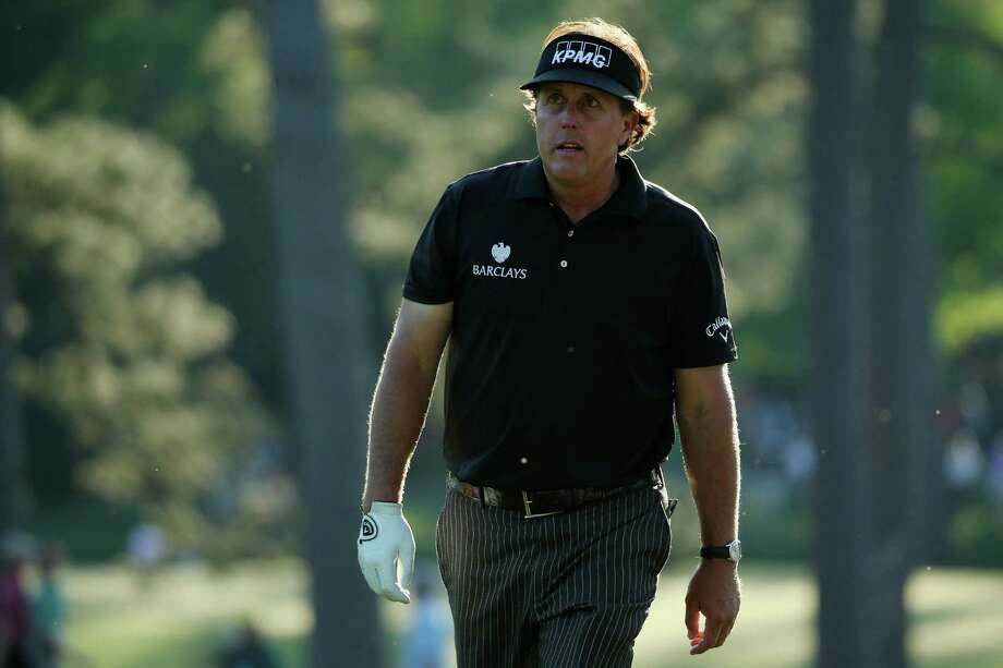 AUGUSTA, GA - APRIL 10:  Phil Mickelson of the United States on the 17th hole during the first round of the 2014 Masters Tournament at Augusta National Golf Club on April 10, 2014 in Augusta, Georgia.  (Photo by Andrew Redington/Getty Images) ORG XMIT: 461742819 Photo: Andrew Redington / 2014 Getty Images