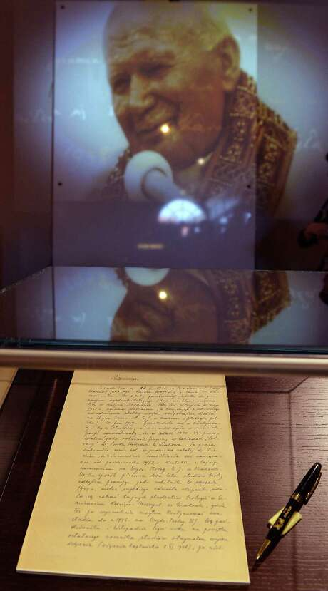 The manuscript of Pope John Paul II's biography is displayed as a part of an exhibit in the Museum of the Holy Father John Paul II Family Home in Wadowice, Poland. Pope Francis will canonize John Paul II at the Vatican on April 27. Photo: Janek Skarzynski Getty Images / JANEK SKARZYNSKI