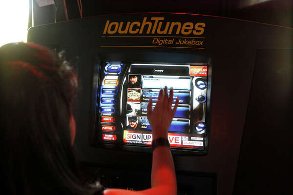 Two plays for a quarter: Bar America's jukebox is unplugged
