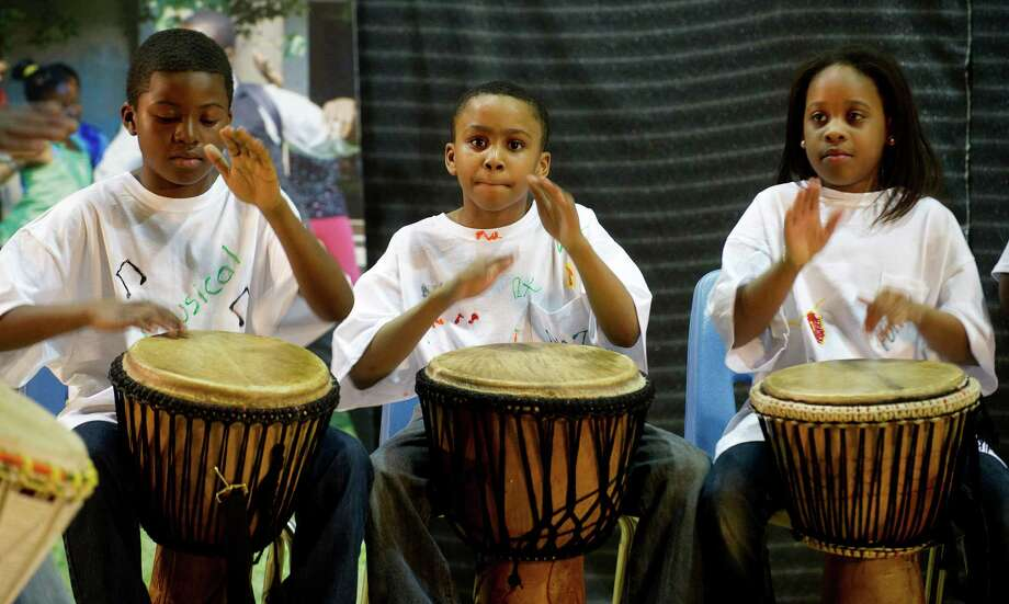 Kids perform African drumming during Family Fun Night at the Boys and Girls Club in Stamford, Conn., on Friday, April 11, 2014. Photo: Lindsay Perry / Stamford Advocate