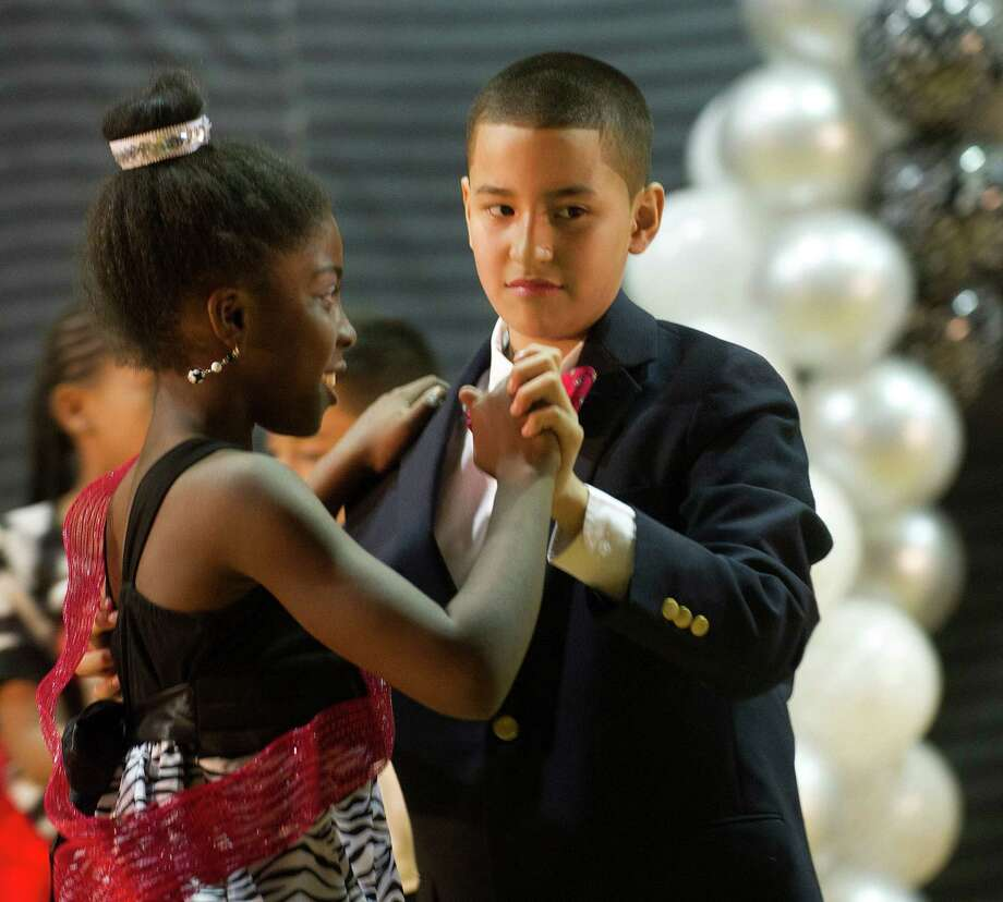 Kids perform ballroom dancing during Family Fun Night at the Boys and Girls Club in Stamford, Conn., on Friday, April 11, 2014. Photo: Lindsay Perry / Stamford Advocate