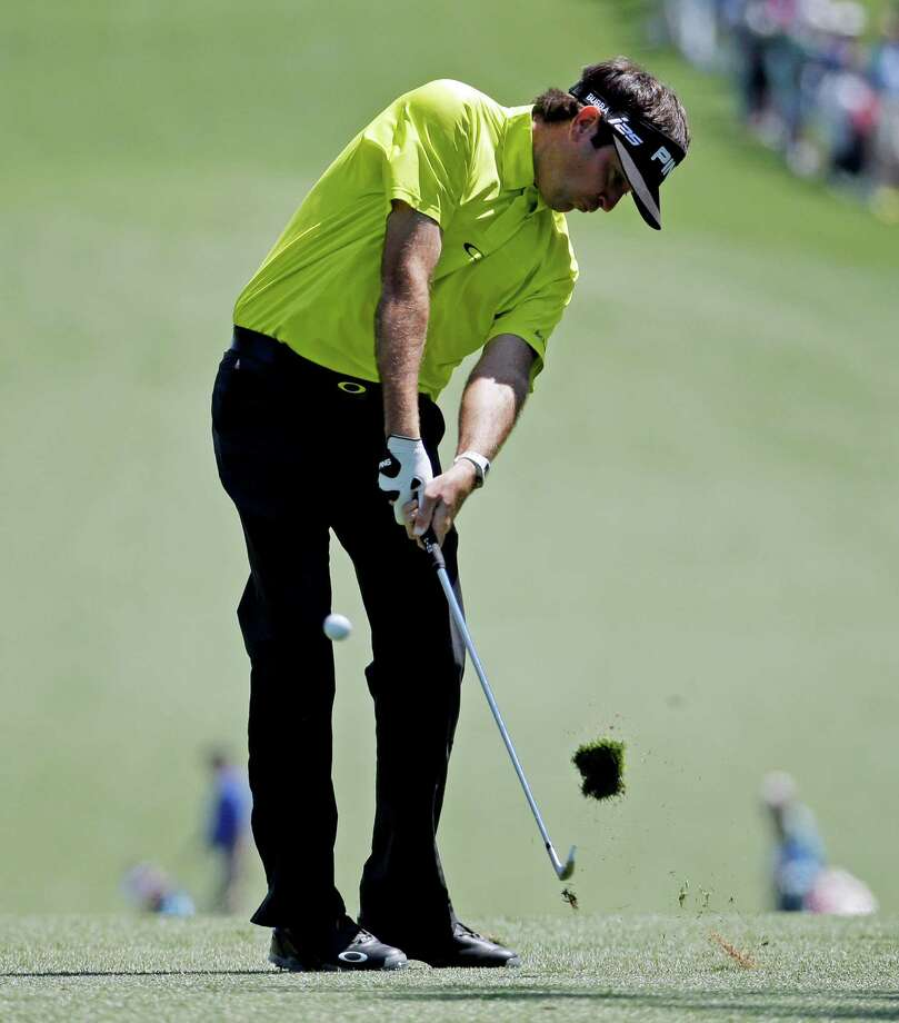 Bubba Watson hits off the first fairway during the first round of the Masters golf tournament Thursday, April 10, 2014, in Augusta, Ga. (AP Photo/Charlie Riedel)  ORG XMIT: AUG252 Photo: Charlie Riedel / AP